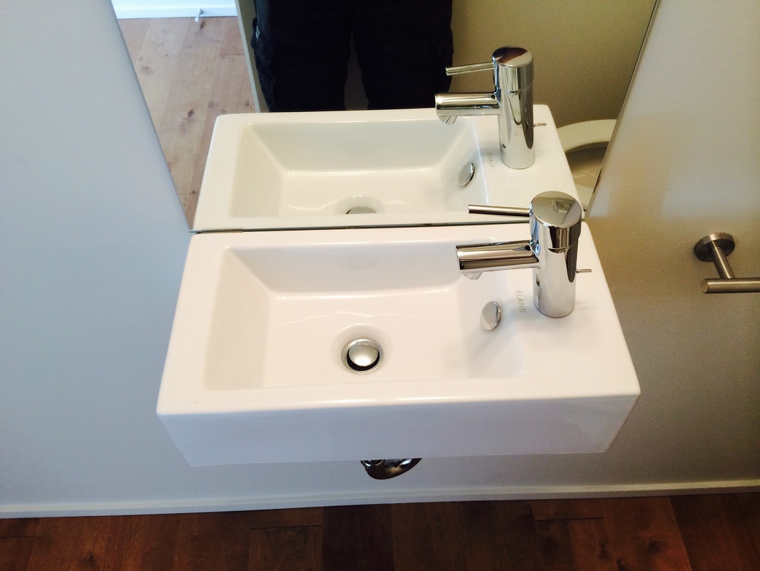 Bathroom sink parallel installation