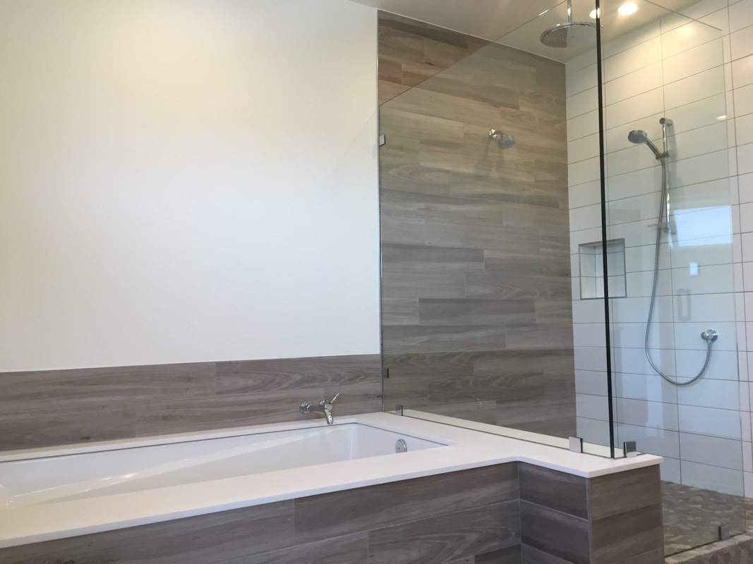 Stone-tiled Tub and Shower